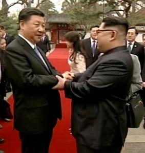 Kim-Jong-Un-Xi-Jinping-shake-hands-1